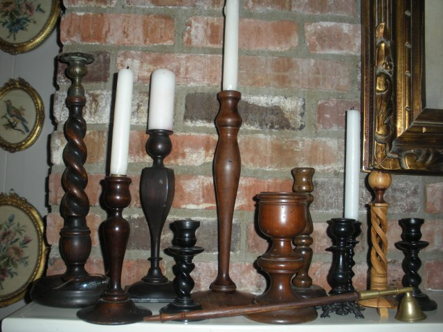Collecting  wooden antique candlesticks.