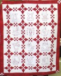 Joan Beard's Red and White embroidered calendar quilt.