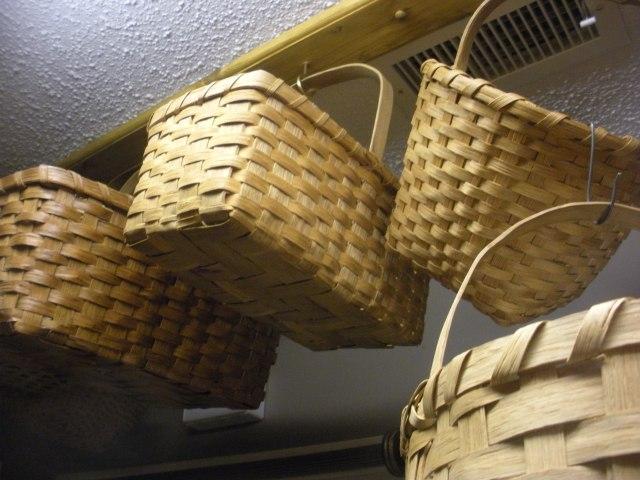 woodburneed bed, baskets, CAQ 057